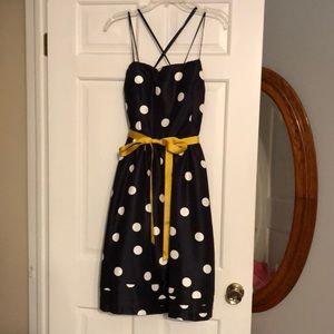 Navy & white polka dot cocktail dress.